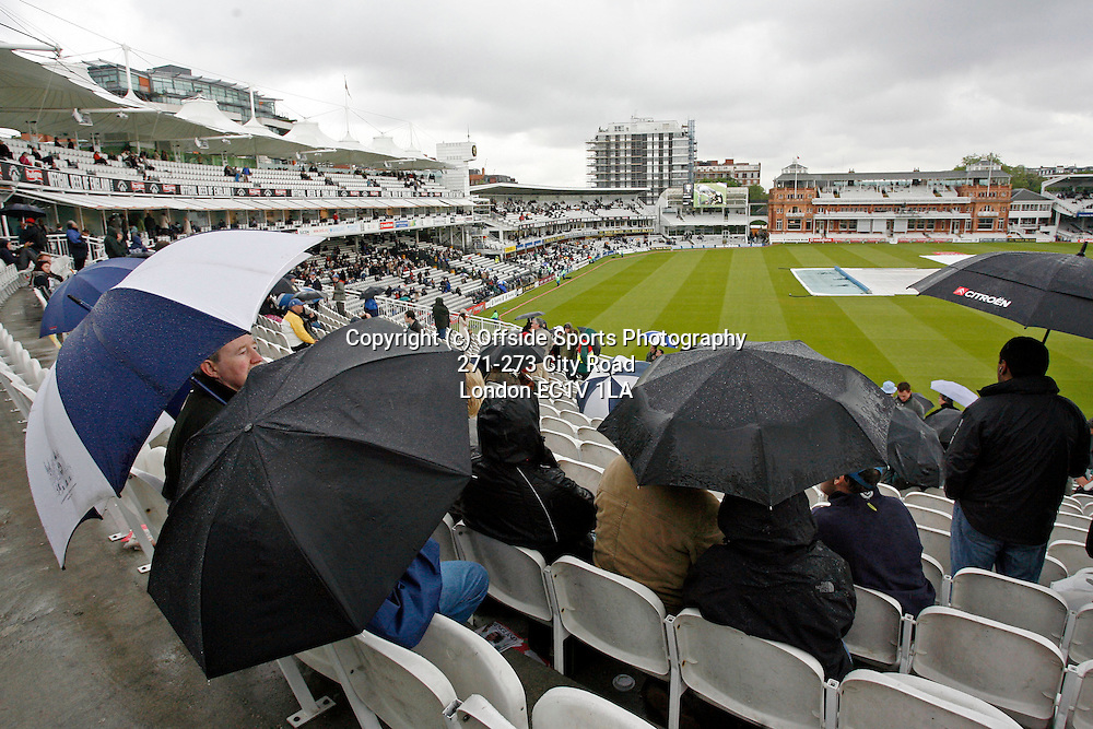 17/05/2008. England v New Zealand - First nPower Cricket Test Match. <br /> GV (general view) of Lord's in the rain with the covers on the pitch and spectators taking shelter under umbrellas.<br /> Photo: Glyn Thomas/Offside
