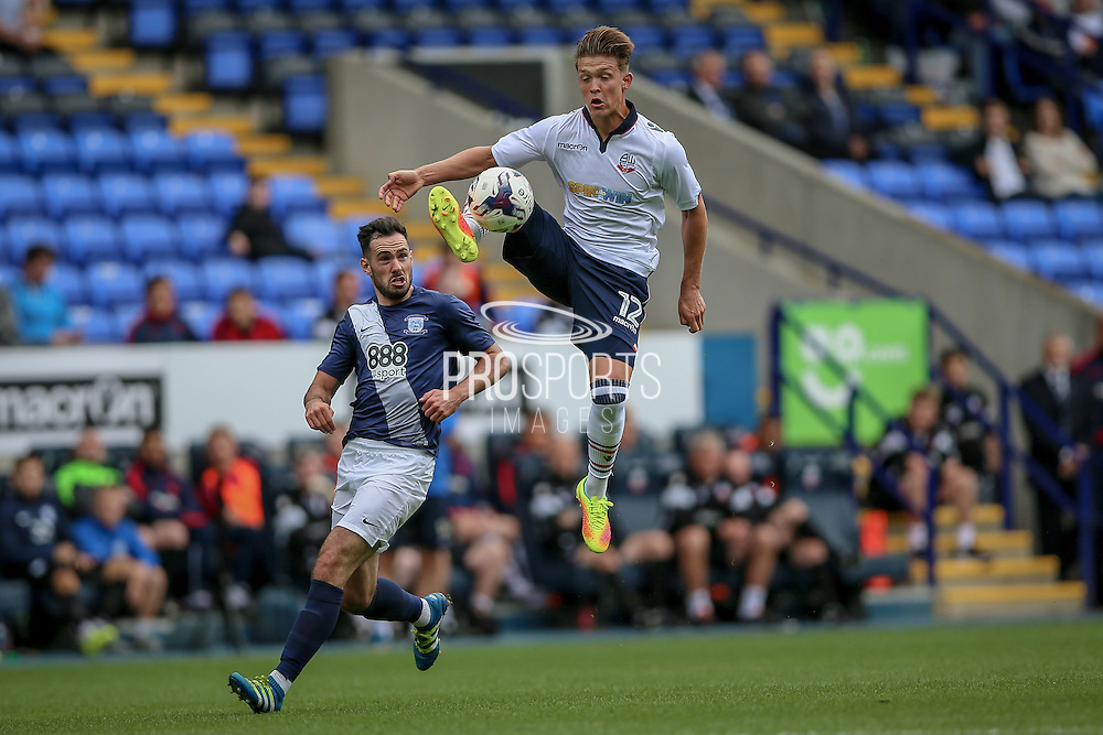 Max Clayton (Bolton Wanderers) controls the ball in the air during the Pre-Season Friendly match between Bolton Wanderers and Preston North End at the Macron Stadium, Bolton, England on 30 July 2016. Photo by Mark P Doherty.