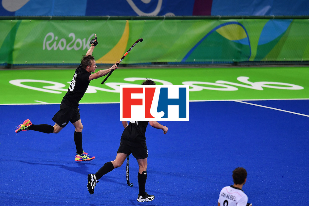 New Zealand's Hugo Inglis (L) celebrates scoring a goal with his teammates during the mens's field hockey Belgium vs New Zealand match of the Rio 2016 Olympics Games at the Olympic Hockey Centre in Rio de Janeiro on August, 12 2016. / AFP / MANAN VATSYAYANA        (Photo credit should read MANAN VATSYAYANA/AFP/Getty Images)