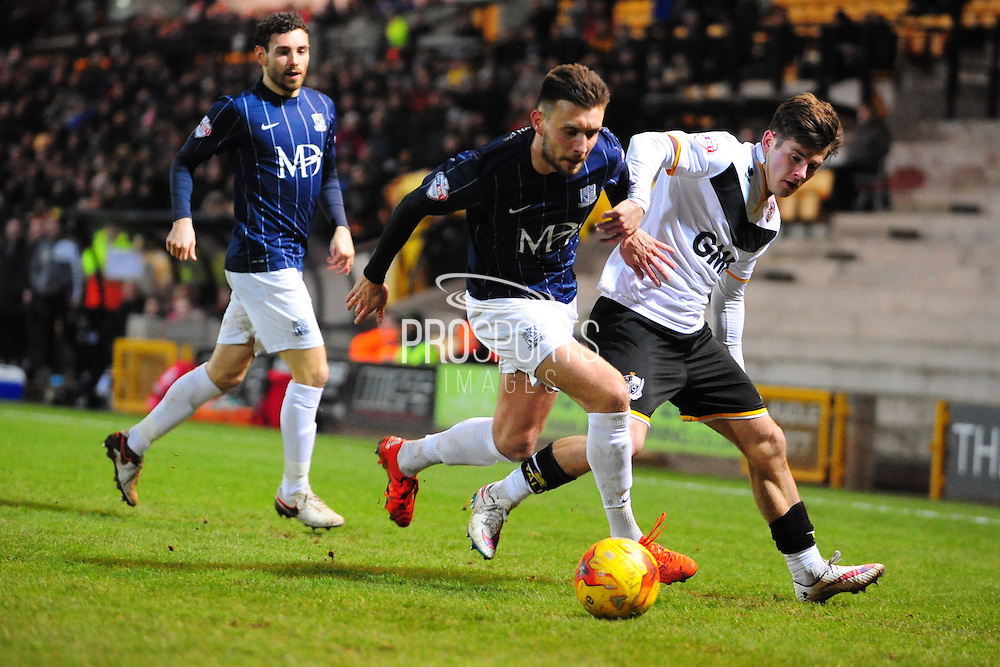 Luke O'Neill of Southend United and Matthew Kennedy during the Sky Bet League 1 match between Port Vale and Southend United at Vale Park, Burslem, England on 26 February 2016. Photo by Mike Sheridan.