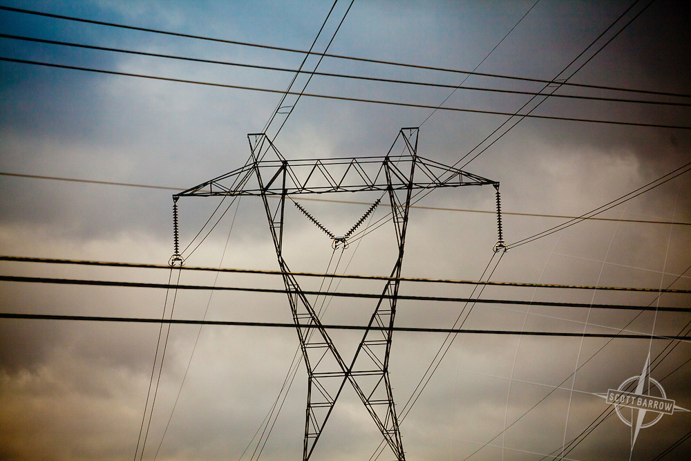 Electrical transmission towers with clouds.