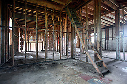 27 August 2014. Lower 9th Ward, New Orleans, Louisiana.<br /> Hurricane Katrina 9 years later. An escape ladder to the attic remains in one of the many derelict, falling down buildings dotting the landscape as the area continues to struggle with recovery from Hurricane Katrina.<br /> Photo; Charlie Varley/varleypix.com