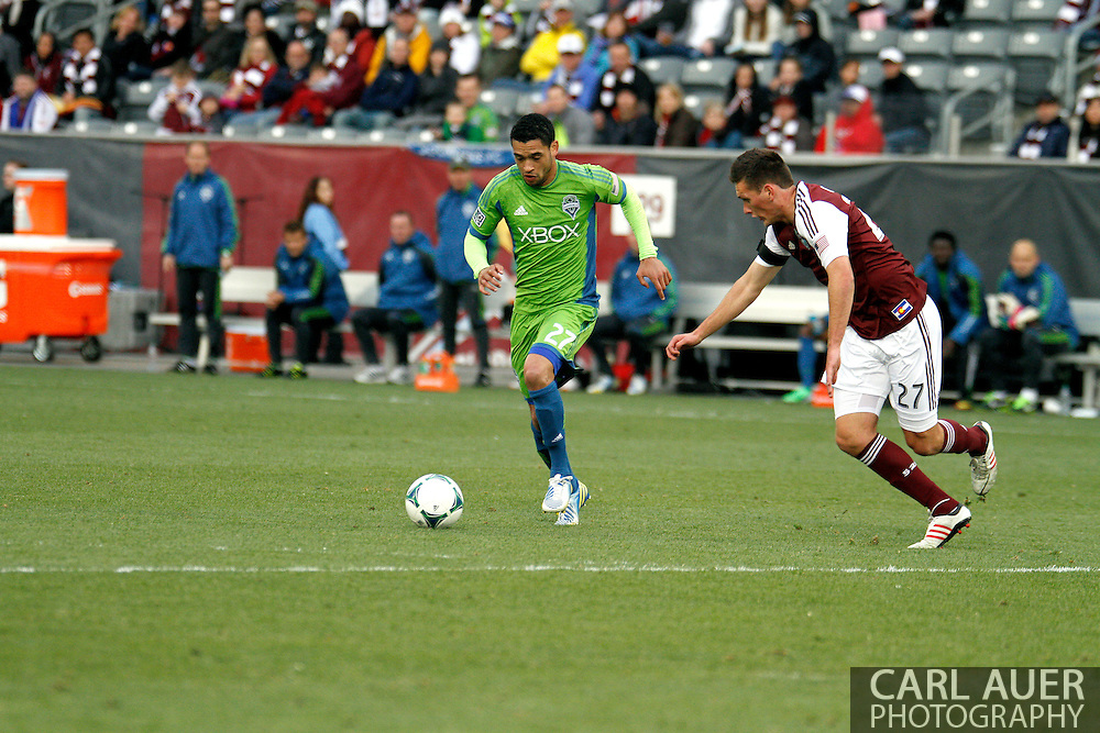 April 20th, 2013 Commerce City, CO - Seattle Sounders FC midfielder Lamar Neagle (27) dribbles the ball up the pitch against the defense by Colorado Rapids midfielder Shane O'Neill (27) in the second half of action in the MLS match between the Seattle Sounders FC and the Colorado Rapids at Dick's Sporting Goods Park in Commerce City, CO