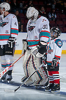 KELOWNA, CANADA - JANUARY 30: Michael Herringer #30 of Kelowna Rockets lines up with the Pepsi Save ON Foods player of the game against the Victoria Royalson January 30, 2016 at Prospera Place in Kelowna, British Columbia, Canada.  (Photo by Marissa Baecker/Shoot the Breeze)  *** Local Caption *** Michael Herringer;