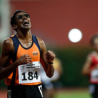 Jeevaneesh S/O Soundarajah of National University of Singapore reacts as he crosses the finish line during the men's 10000m event. (Photo &copy; Lim Yong Teck/Red Sports) The 2018 Institute-Varsity-Polytechnic Track and Field Championships were held over three days in January.<br />