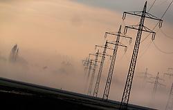 THEMENBILD - Stromleitungen ud Strommasten auf Feldern im Nebel, aufgenommen am 23. November 2016, Oberding in Bayern, Germany // Power lines with masts on fields in the fog, Oberding, Bayern, Germany on 2016/11/23. EXPA Pictures © 2016, PhotoCredit: EXPA/ JFK