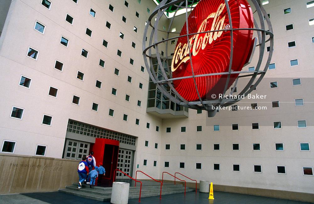 Visitors enter the Coca-Cola corporate museum in the company's Atlanta headquarters.