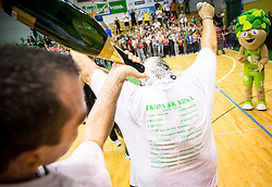Jasmin Hukic of Krka and Aleksandar Dzikic, head coach of Krka celebrate with a champaign after winning during basketball match between KK Krka and KK Union Olimpija Ljubljana in 5th Final match of Telemach League - Slovenian Championship 2013/14 on May 31, 2014 in Dvorana Leona Stuklja, Novo mesto, Slovenia. KK Krka won the game and became Slovenian National Champion 2014. Photo by Vid Ponikvar / Sportida