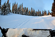 USA, Idaho, Valley County, Donnelly, Tamarack Resort, View of Snow Cat grooming road to summit of West Mountain