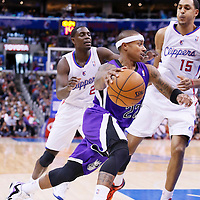 23 November 2013: Sacramento Kings point guard Isaiah Thomas (22) drives past Los Angeles Clippers point guard Darren Collison (2) and Los Angeles Clippers center Ryan Hollins (15) during the Los Angeles Clippers 103-102 victory over the Sacramento Kings at the Staples Center, Los Angeles, California, USA.