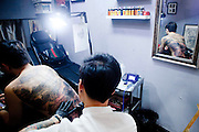 """ZHUZHOU, CHINA - APRIL 18: (CHINA OUT) <br /> <br /> Man Has whole painting Tattooed on to his back<br /> <br /> 24-year-old Yang Zhengwei gets a tattoo of """"Qingming Picture"""", which is adapted from a famous Chinese painting on April 18, 2014 in Zhuzhou, Hunan Province of China. The 50-centimetre-long, 38-centimetre-wide tattoo on Yang's back was almost finished after five days of work by 38-year-old A Wei(nickname). The painting, attributed to Song Dynasty artist Zhang Zeduan, was originally a panoramic painting on a scroll depicting the daily life scenery of a river in the capital Bianjin. <br /> ©Exclusivepix"""