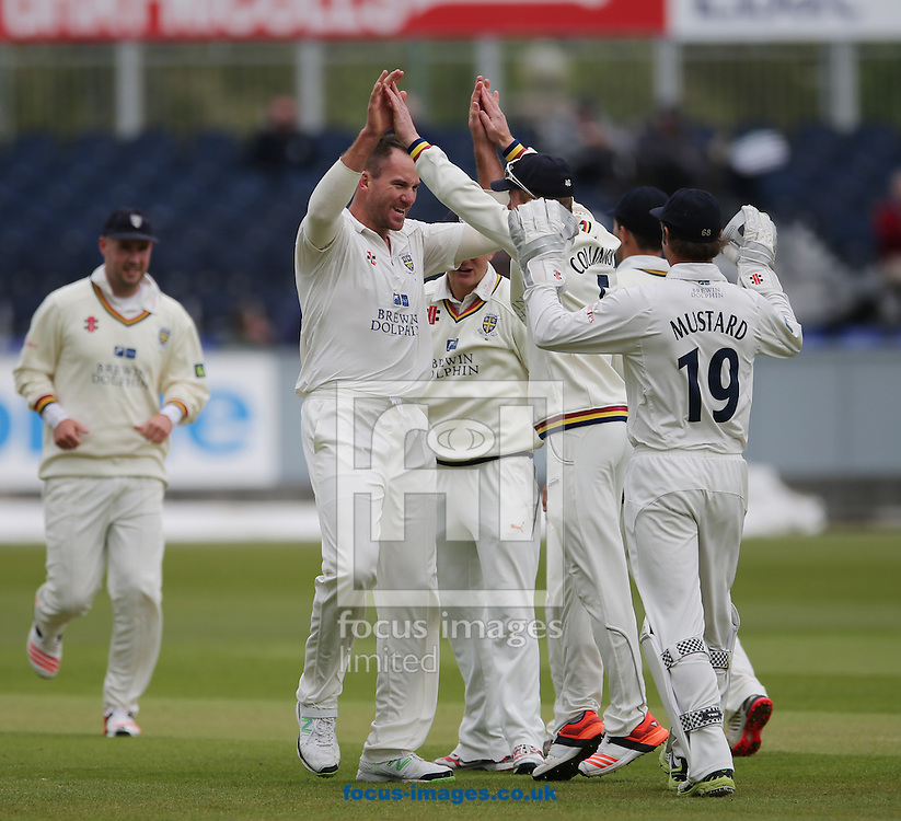 John Hastings (2nd left) of Durham is congratulated on the wicket of James Taylor (not shown) of Nottinghamshire during the LV County Championship Div One match at Emirates Durham ICG, Chester-le-Street<br /> Picture by Simon Moore/Focus Images Ltd 07807 671782<br /> 10/05/2015