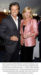 Multi-millionaire RICHARD & JACKIE CARING, at a reception in London on 8th October 2002.	PDU 25