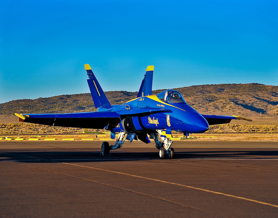 A Blue Angel sits parked on the ramp between shows