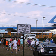 Sightseers gather to see and take pictures of Air Force One, the President's airplane at Palm Beach International Airport, PBI. The Boeing 747 brought President Trump to his winter White House in Palm Beach.<br /> Photography by Jose More