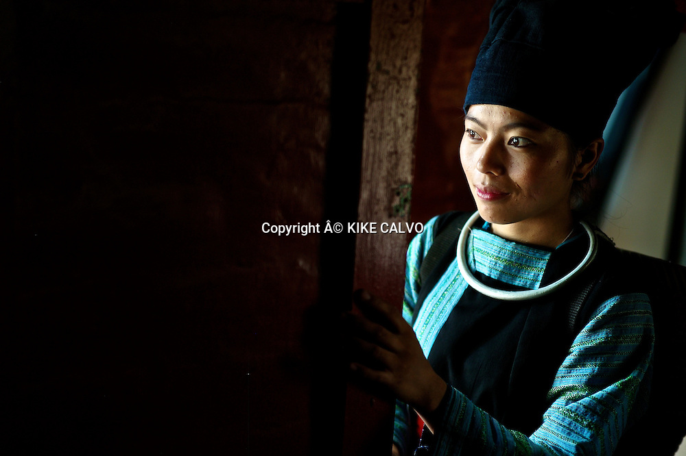 Young girl wearing a Hmong Dam traditional dress in Laos.