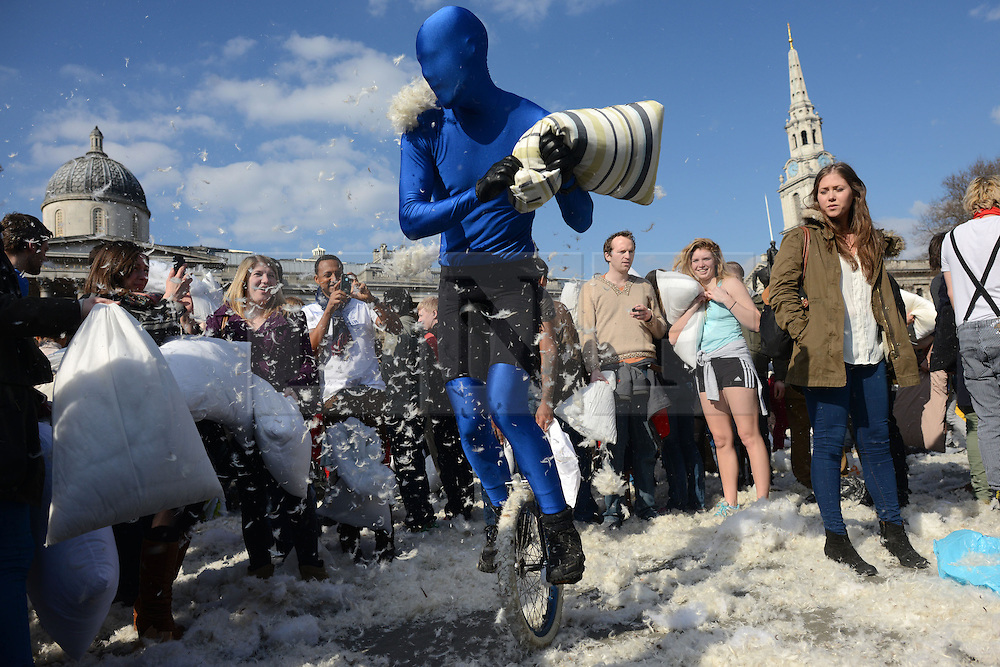 © Licensed to London News Pictures. 06/04/2013. London, UK. International Pillow Fight Day. Hundreds of people gather for a mass pillow fight in Trafalgar square on April 6, 2013 in London, England..Photo credit : Peter Kollanyi/LNP