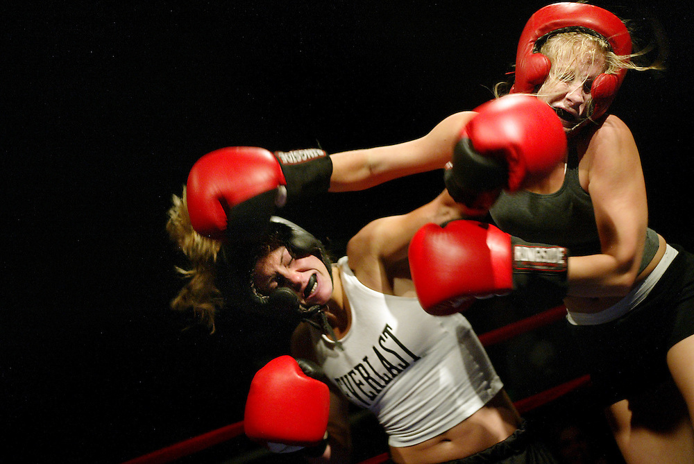 Female Boxers duke it out at College Fight Night at the Fox Theater in Boulder, Colo. The event also featured men's lightweight, middleweight and heavyweight boxing and midget boxing.