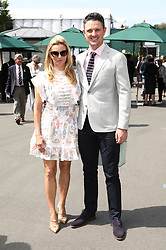 English professional golfer Justin Rose (right) and wife Kate Phillips on day seven of the Wimbledon Championships at the All England Lawn Tennis and Croquet Club, London.