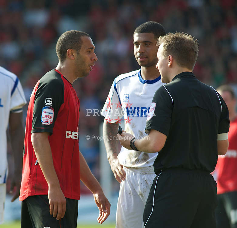 BOURNEMOUTH, ENGLAND - Saturday, April 9, 2011: Tranmere Rovers' Joss Labadie and Bournemouth's Anton Robinson are both spoken to by the Referee during the Football League One match at the Dean Court Stadium. (Photo by Gareth Davies/Propaganda)