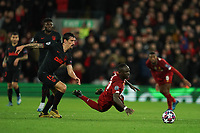 Football - 2019 / 2020 UEFA Champions League - Round of Sixteen, Second Leg: Liverpool (0) vs. Atletico Madrid (1)<br /> <br /> Liverpool's Sadio Mane is fouled by Stefan Savic of Atletico Madrid, at Anfield.<br /> <br /> <br /> COLORSPORT/TERRY DONNELLY