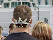 boy wearing New York souvenir sunglasses