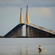 An unidentified fisherman wades in the waters just north of the Sunshine Skyway Bridge Wednesday, July 9, 2014 in St. Petersburg. CHRIS URSO/STAFF