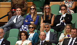 Eddie Redmayne and his wife Hannah in the royal box with Hugh Grant (right) and Anna Eberstein on day thirteen of the Wimbledon Championships at The All England Lawn Tennis and Croquet Club, Wimbledon.