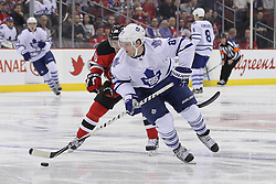 Mar 23; Newark, NJ, USA; Toronto Maple Leafs right wing Phil Kessel (81) skates with the puck while being chased by New Jersey Devils right wing Petr Sykora (15) during the first period at the Prudential Center.