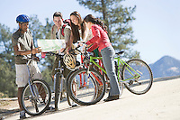 Group of friends looking at map on cycling holiday