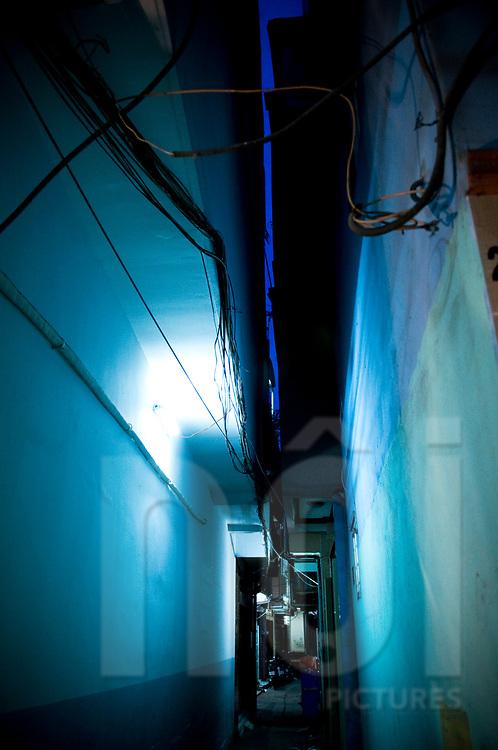 Narrow alleyway at night, Ho Chi Minh city, Vietnam, Southeast Asia