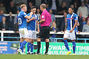 referee Chris Sarginson shows Rochdale FC midfielder Callum Camps (10) the red card during the EFL Sky Bet League 1 match between Rochdale and AFC Wimbledon at Spotland, Rochdale, England on 27 August 2016. Photo by Stuart Butcher.