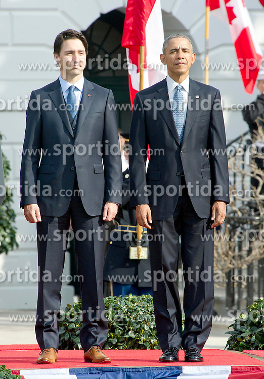 United States President Barack Obama, right, and Prime Minister Justin Trudeau of Canada, left, listen to the National Anthems during an Arrival Ceremony on the South Lawn of the White House in Washington, DC on Thursday, March 10, 2016. Credit: Ron Sachs, CNP - NO WIRE SERVICE -. EXPA Pictures &copy; 2016, PhotoCredit: EXPA/ Photoshot/ Ron Sachs<br /> <br /> *****ATTENTION - for AUT, SLO, CRO, SRB, BIH, MAZ, SUI only*****