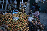 """Joseph Patrick, a fifties jamaikan traveler, Rasta faith, select some fruits for his dinner. Main market of Shashemene, south Ethiopia, on thursday, March 20 2008.....""""Shashamene or Shashemene (ethiopian name), located in the Oromia Region of Ethiopia, is """"the place"""", the ancestral homeland. For the whole Rastafarians repatriation to Africa or to Zion or to the Promise Land is the first goal. Rastas assert that """"Mount Zion"""" is a place promised by Jah and they  claim themselves to represent the real Children of Israel in modern times. During the last years of the 40's, Emperor Haile Selassie I, considerated from that movement incarnation of God, donated 500 acres of his private land to members and other settlers from Jamaica including other parts of the Caribbean..The Rastafarian settlement in Shashamane was recently reported to exceed two hundred families. In January 2007 it organized an exhibition and a bazaar in the city. It was also reported recently prior to the Ethiopian Millennium that various pro-Ethiopian World Federation groups, consisting of indigenious Ethiopians and Rastafarians, have given support to one of many five year plans proposed for sustainable development of Shashamene, Ethiopia."""""""