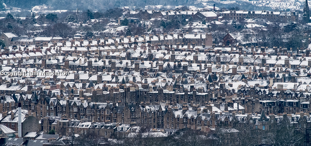 Edinburgh, Scotland, United Kingdom. 29 December, 2017; Snow falls on Edinburgh enhancing views of the city. Rooftops of apartment buildings in Bruntsfield and Marchmont covered in snow.