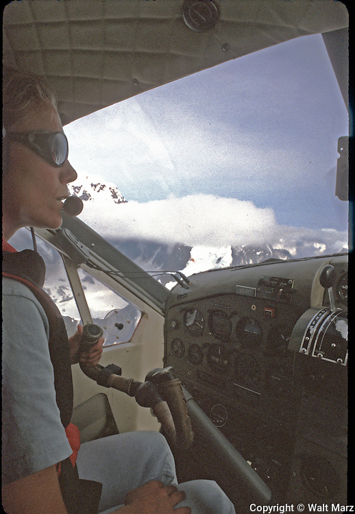 Taken from the cockpit of ski-equipped DeHaveland Beaver; as we were flying along the East Buttress of Mt. McKINLEY. The aircraft was at it's maximum ceiling of 11000 feet
