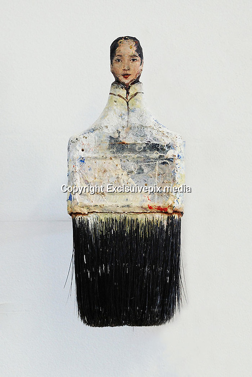 """Artist transforms old paintbrushes into delicate Ladies<br /> <br /> San Francisco-based artist Rebecca Szeto uses paintbrushes to create her artwork, but we're betting you weren't expecting exactly how she uses them. She carves the ends of her used paintbrushes into refined painted renaissance ladies, and the colorful used brush hairs become the sweeping elegant fibers of their gowns.<br /> <br /> """"These works play with notions of re-forming beauty and value,"""" writes Szeto in her artist's statement. """"I use humble, end-of-life, mass-produced materials inspired by my experience as a faux finisher.""""<br /> ©Rebecca Szeto/Exclsuivepix media"""