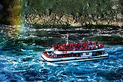 Sightseeing boat approaches Horseshoe Falls, Niagra Falls, Ontario, Canada.