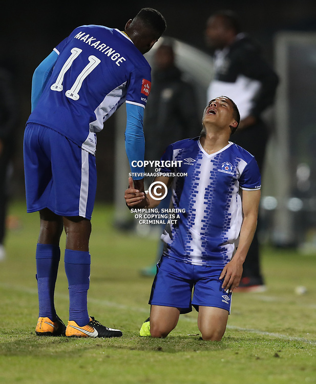 DURBAN, SOUTH AFRICA - AUGUST 23: Fortune Makaringe of Maritzburg Utd and Devon Saal of Maritzburg Utd during the Absa Premiership match between Maritzburg United and Ajax Cape Town at Harry Gwala Stadium on August 23, 2017 in Durban, South Africa. (Photo by Steve Haag/Gallo Images)