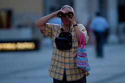 Fan watching with binoculars during reception of Slovenian Olympic Team at Kongresni Trg when they came back from London after Summer Olympic games 2012, on August 14, 2012 in Center of Ljubljana, Slovenia (Photo by Matic Klansek Velej / Sportida.com)