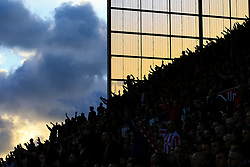 9 September 2017 -  Premier League - Stoke City v Manchester United - Stoke City fans silhouetted abasing the skyline - Photo: Marc Atkins/Offside