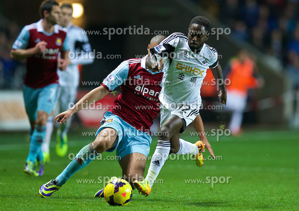 27.10.2013, Liberty Stadion, Swansea, ENG, Premier League, Swansea City vs West Ham United, 09. Runde, im Bild Swansea City's Nathan Dyer, action against West Ham United's Winston Reid c // during the English Premier League 09th round match between Swansea City AFC and West Ham United at the Liberty Stadion in Swansea, Great Britain on 2013/10/27. EXPA Pictures &copy; 2013, PhotoCredit: EXPA/ Propagandaphoto/ David Rawcliffe<br /> <br /> *****ATTENTION - OUT of ENG, GBR*****