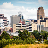 Photo of Cincinnati skyline and downtown city buildings including Carew Tower, PNC Tower, Fifth Third Bank building, and Macy's building.