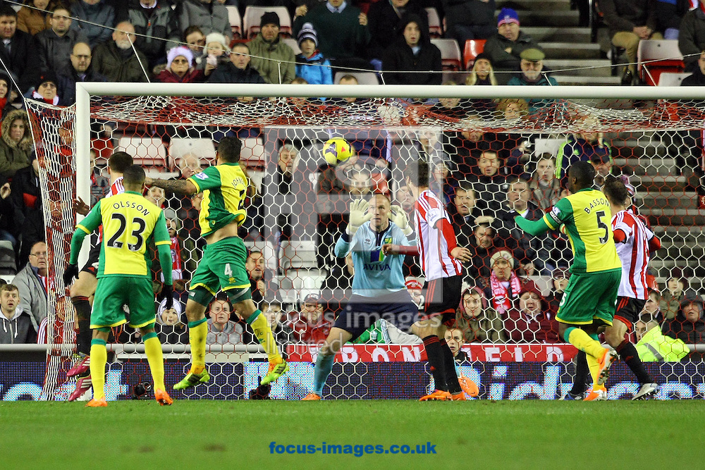 Picture by Paul Chesterton/Focus Images Ltd +44 7904 640267<br /> 21/12/2013<br /> Sunderland's Phil Bardsley heads for goal during the Barclays Premier League match at the Stadium Of Light, Sunderland.
