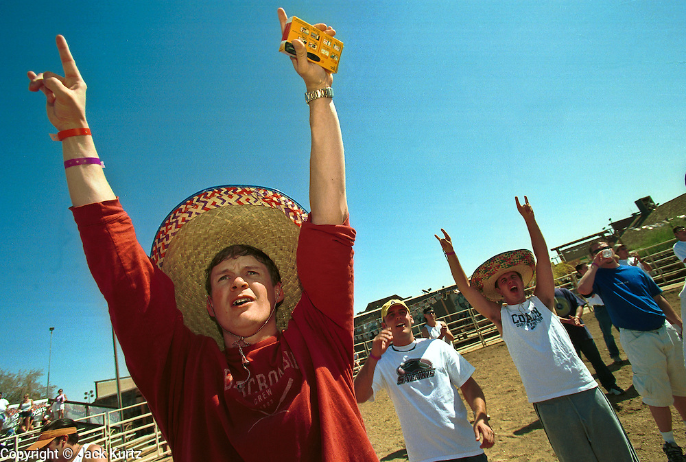 05 MAY 2002 - SCOTTSDALE, ARIZONA, USA: Participants in the 1st Annual Running of the Bulls at Rawhide in Scottsdale, Arizona, cheer before the start of the run, Sunday, May 5, 2002. The event was a part of a Cinco de Mayo celebration. About 400  people paid up to $80 each to run with the bulls. The event was fashioned after the running of the bulls in Pamplona, Spain. .PHOTO BY JACK KURTZ