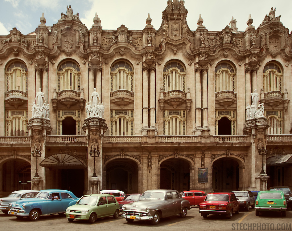Vintage cars parked outside of the Gran Teatro de La Habana in downtown Havana, Cuba.