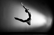 human flight.  ballet dancer rusty toth into the light at studio shoot in durango, colorado.