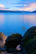 Idaho, North, Coeur d'Alene. Evening from the rocky shoreline of Tubbs Hill nature Park and Lake Coeur d'Alene.