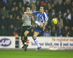 WIGAN, ENGLAND - TUESDAY, JANUARY 31st, 2006: Everton's Leon Osman and Wigan Athletic's Leighton Baines during the Premiership match at the JJB Stadium. (Pic by David Rawcliffe/Propaganda)