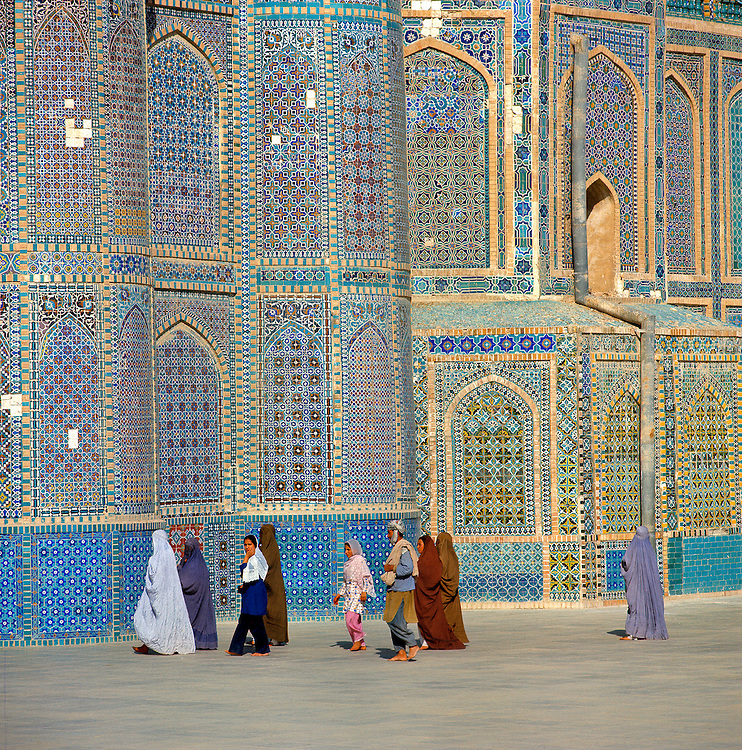 Visitors walk to the entrance of the Shrine to Hazrat Ali in Mazar-i-Sharif, Afghanistan.